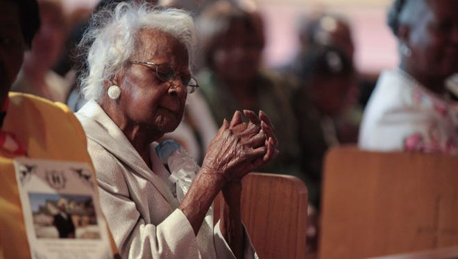 Jeralean Talley from Inkster enjoys the music during service at her 116th birthday celebration ,
