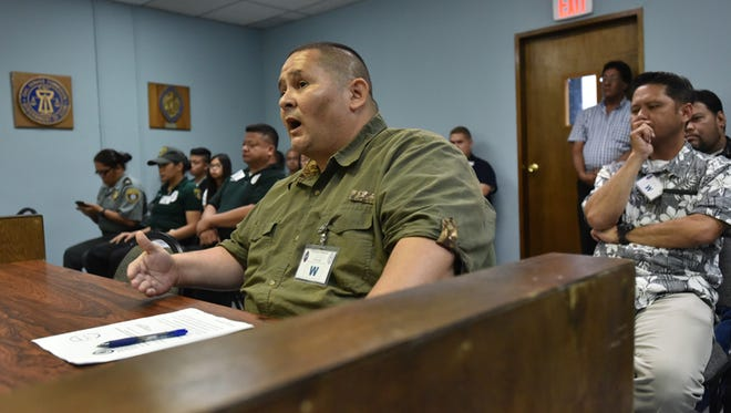 """Department of Corrections Lt. Antone Aguon, front, speaks in front of the Civil Service Commission on May 28, regarding department personnel promotions that were deemed not to have follow procedure. The commission voted to uphold its May 7 vote to void and nullify the promotions, despite testimony from DOC Director Jose San Agustin who asked the commission not to """"punish"""" the promoted employees. Masako Watanabe/Pacific Daily News/mwatanabe@guampdn.com"""
