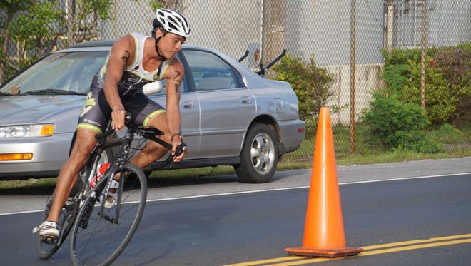 Patrick Camacho competes in the cycling portion of the Dual Distance Triathlon in Piti on Sunday, May 31, 2015. Camacho was the first-place finisher in the sprint distance event which included a 750-meter swim, 20-kilometer bike and 5-kilometer run.Grant Wieman/Pacific Daily News/gwieman@guampdn.com