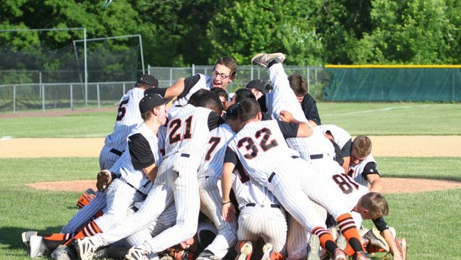 Mamaroneck dog piles after winning a Class AA state championship with a 9-2 win over Saratoga Springs at Union-Endicott HS on Saturday, June 13.