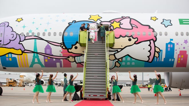 Hello Kitty emerges from the brand-new Boeing 777-300 for EVA Air at a welcome party for EVA's new service to Houston on June 19, 2015.