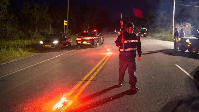MALONE, NY - JUNE 26:  Department of Correction officers man a roadblock near the scene where escaped convict Richard Matt was shot and killed by law enforcement officers who had been hunting for him and fellow escapee David Sweat on June 26, 2015 in Malone, New York. Police have been searching for Matt and Sweat since they were discovered missing from a prison in nearby Dannemora on June 6. According to authorities Sweat is still at large in the area. (Photo by Scott Olson/Getty Images) *** BESTPIX ***