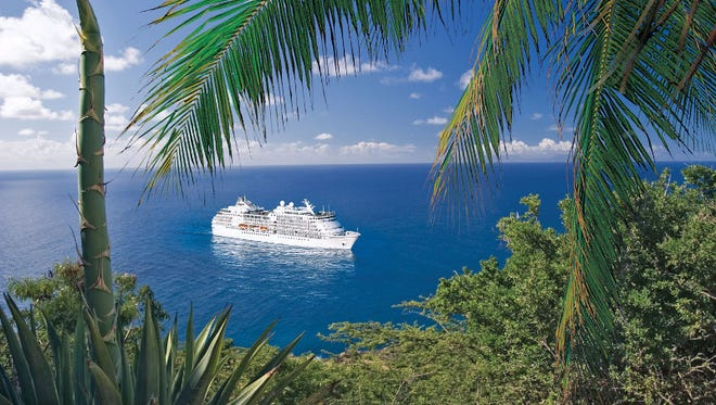 The 490-passenger Seven Seas Navigator at anchor in the tropics.