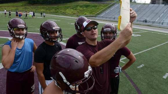 Nathan Padgett was hired to coach Owen's football team in April.