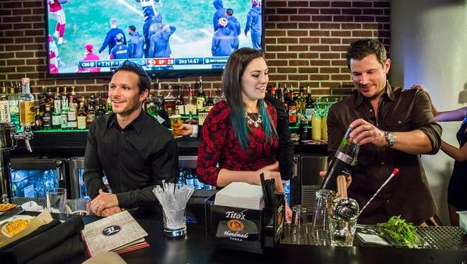 The Lacheys with their new main bartender, Alyx.