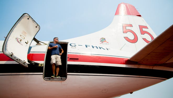 A crew member aboard a Convair 580 fire-bomber waits for a call on a slow morning at the USFS Air Tanker Base in Moses Lake, Wash., on Aug. 23, 2015.