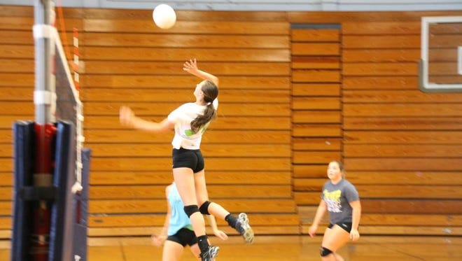 SallyAnne Johnson goes up for a kill during Tuesday's practice in Candler.