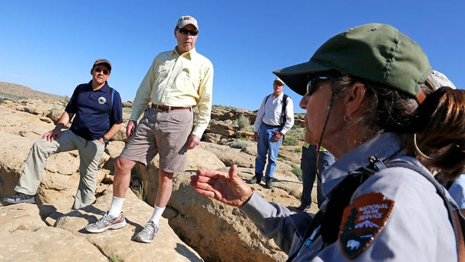 U.S. Department of the Interior Deputy Secretary Mike Connor, left, and New Mexico Sen. Tom Udall, listen to Dabney Ford, chief of cultural resources at Chaco Culture National Historical Park on June 29, 2015, during a fact-finding tour.
