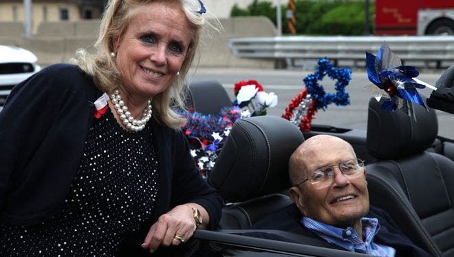 Debbie Dingell with her husband former United States Representative John Dingell during  Dearborn's 91st annual Memorial Day parade on Michigan Ave. in Dearborn on Monday, May 25, 2015.