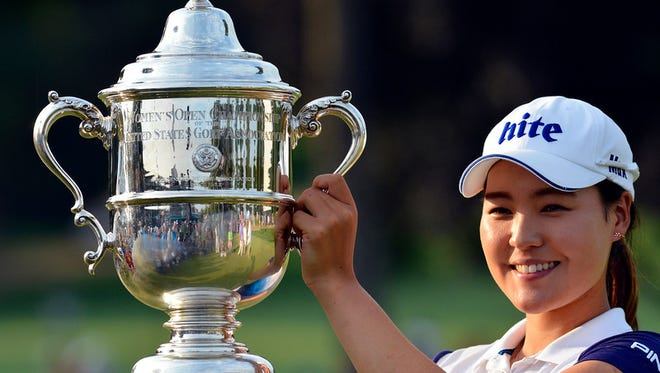 """""""In Gee Chun holds Harton S. Semple Trophy after winning the US Women's Open in Lancaster, Sunday July12, 2015. Chun shot 68-70-68-66 to win at 8 under par. John A. Pavoncello - jpavoncello@yorkdispatch.com"""""""
