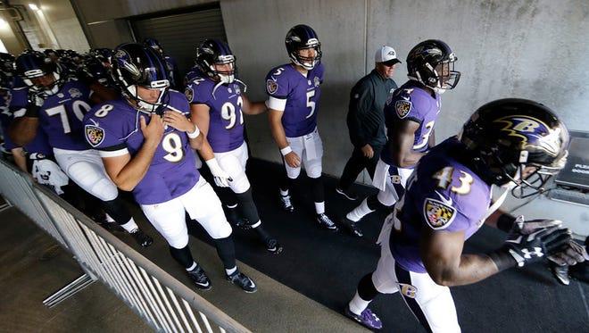 """Baltimore Ravens players run onto the field before a preseason NFL football game against the Philadelphia Eagles, Saturday, Aug. 22, 2015, in Philadelphia."