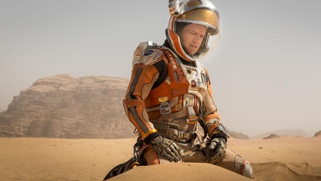 Matt Damon portrays an astronaut who faces seemingly insurmountable odds as he tries to find a way to subsist on a hostile planet in the motion picture 'The Martian.'