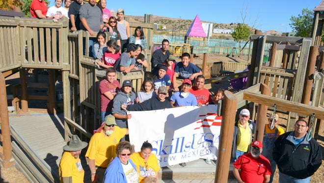 "One of the many projects the Deming High School SkillsUSA students completed was to refurbish a weather-beaten children's playground in the Gallup, NM area while performing community service during the Community Outreach and Leadership Conference ""Project Helping Hands."""