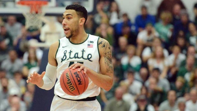 Nov 27, 2015; Fullerton , CA, USA; Michigan State Spartans guard Denzel Valentine (45) brings the ball up court against the Boise State Broncos during the first half at Titan Gym.