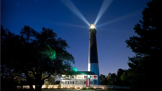 The Pensacola Lighthouse and Museum at night.