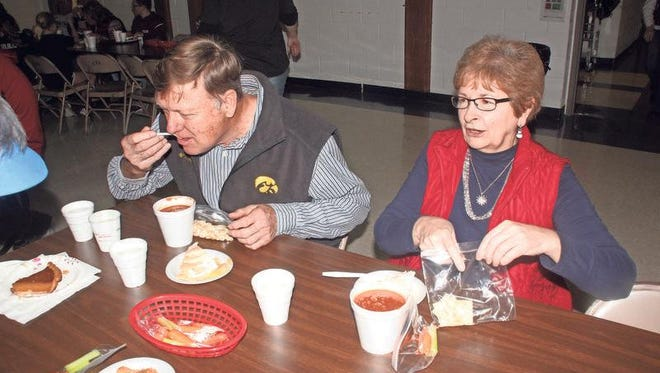 Earl Glandorf (left) and Suzanne Burnham enjoy conversation and a good cup of chili at Lutheran Interparish School's annual Chili Bowl fundraiser Friday, Jan. 8.