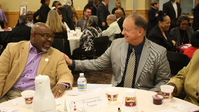 Jeffersonville City Council Member Dustin White talks with Mayor Mike Moore during the Annual King Scholarship Breakfast held at Indiana University Southeast on Saturday.