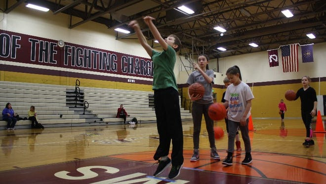 Maven Campbell, 10, attempts a free throw during the Clarksville Optimist Tri-Star Basketball skills contest on Saturday.