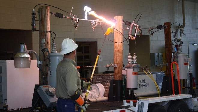 """Duke Energy Lineman Paul Kendall demonstrates the danger of touching a live power line during a """"live line"""" safety training session for the Jeffersonville Fire Department at the Jeffersonville Fire headquarters on Thursday.  February 11, 2016"""