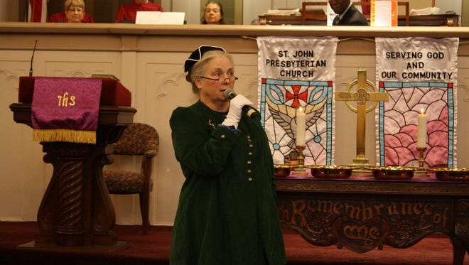 Historical reenactor Mandy Dick portrays Hattie Scribner during the St. John United Presbyterian Church Bicentennial service in New Albany on Sunday (By Jenna Esarey, special to The Courier-Journal)  February 14, 2016