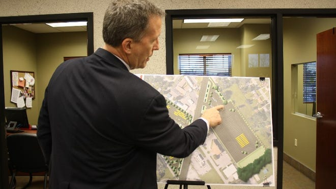 Greater Clark County Schools Superintendent Dr. Andrew Melin talks with the media and the public about plans to convert the Clark County Auto Auction site in Jeffersonville into a new transportation center at an open house on Monday.