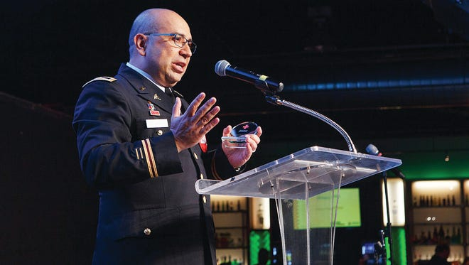 Physician assistant Victor Palomares was recently recognized for his dedication and sacrifice as an Army Reserve colonel during the American Red Cross Heroes Soiree on Feb. 26. His military experience helps him help other returning soldiers.