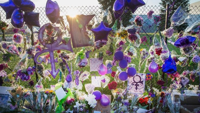 Mementos left by fans are attached to the fence which surrounds Paisley Park, the home and studio of Prince, on April 23, 2016, in Chanhassen.