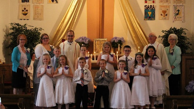 The First Holy Communion Class of 2016  from  Holy Name of Mary Parish in Maplewood were blessed to receive the Sacrament of Holy Eucharist for the first time on Sunday, May 1. Front row:   Samantha Massart, Hailey Bosman, Tucker Cornette, Nora LeFevre, Frances Nellis.  Second row:  Colt Gilbertson, Noelle Patza, Carrie Renard, Braden Crewe, Sara Montana. Back row:  Teacher Lori Kruswick, coordinator Sarah Larson,  Father Carl Schmitt,  Father Tony Birdsall,  teacher  Clarice Cornette.