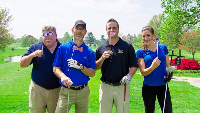 Representatives from Kunzler join Ryan Krebs, director of food services at Rutter's Farm Stores, at the 13th hole of the Out Door Country Club's golf course, during a golf outing on May 2. Krebs is shown second from left.