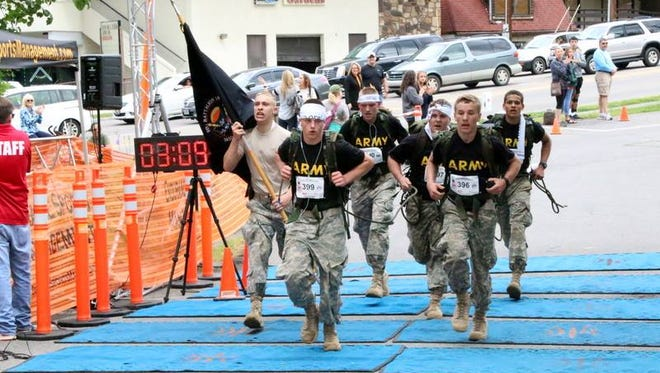 Fairview JROTC cadets cross finish line in Mountain Man Memorial March.