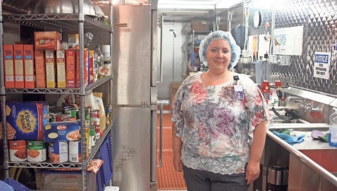 Amanda Thede, certified dietary manager at Marengo Memorial Hospital, stands inside the mobile kitchen unit at the hospital, which will be in use during the hospital construction project.