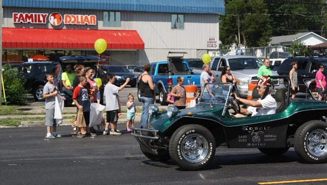 Spectators line Market Street during the annual Charlestown Founder's Day Festival Parade on Saturday, June 25, 2016.