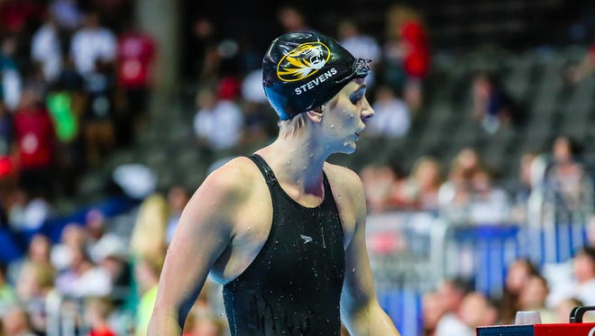 Hannah Stevens emerges from the pool after competing in the 100 meter backstroke at the Olympic Trials in Omaha, Nebraska.