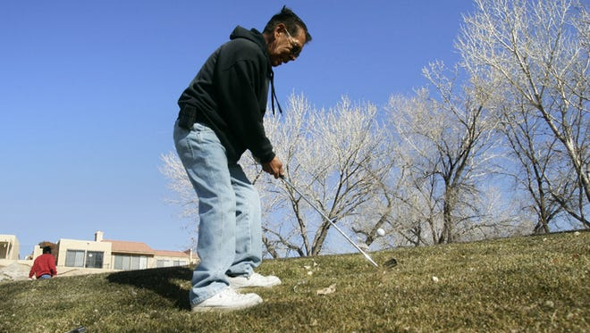 Leo Maestas plays a round of golf at Civitan Golf Course in January 2012. The course could soon serve as the site of a mini golf course.