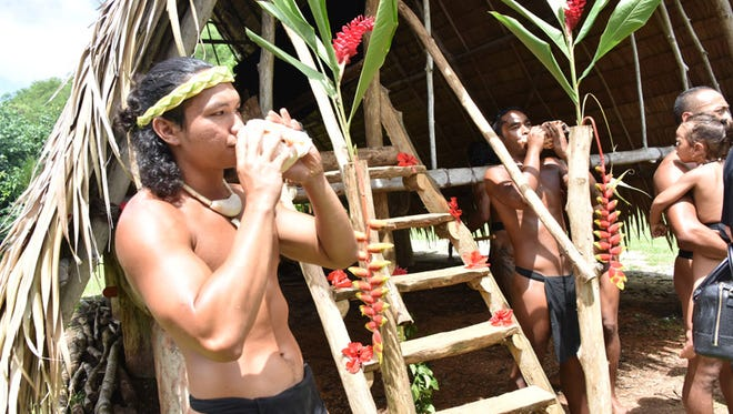 Lorenzo Reyes of the traditional seafaring group Ulitao blows a kulo' during a blessing and ribbon cutting ceremony of its new home at the Valley of the Latte Adventure Park in Talofofo on July 14.
