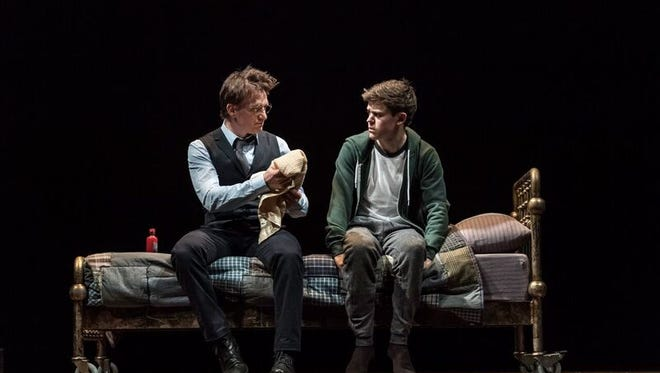 The grown Harry Potter (Jamie Parker) confers with son Albus (Sam Clemmett) in the new London production of 'Harry Potter and the Cursed Child.'