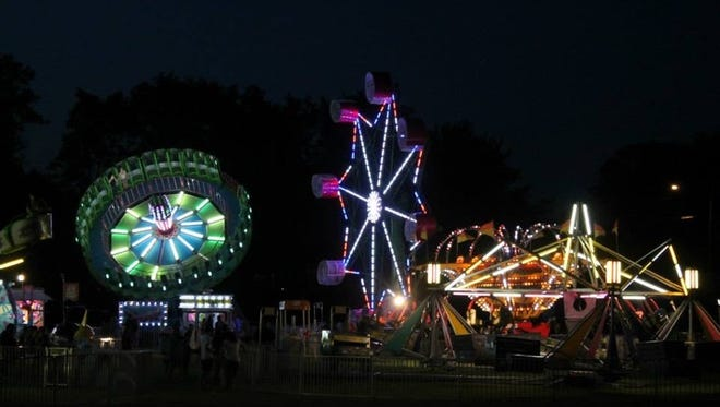 Colorful lights and rides brighten the night sky in the Mishicot Village Park during Riverfest every summer.