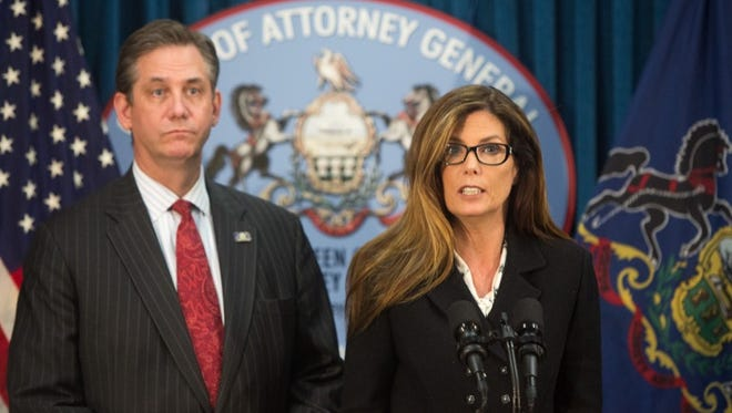 Attorney General Kathleen G. Kane, center, announces Friday her office has reached an agreement with the Hershey Trust Co. and the Milton Hershey School that implements significant reforms to improve the operation and governance of both entities.
