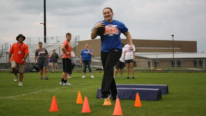 Hannah Mattingly runs a drill during the inaugural Gridiron Girls Ladies Football Clinic at Silver Creek High School in Sellersburg on Friday.