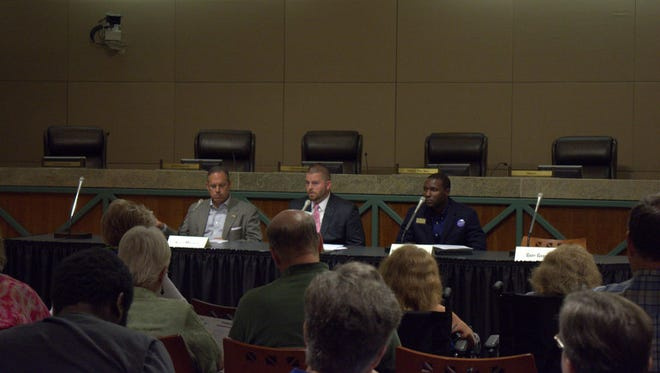 The candidates take questions from the League of Women Voters and other community members during the open forum.