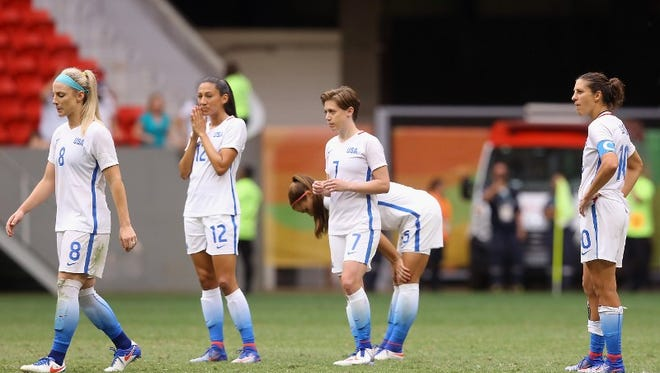 BRASILIA, BRAZIL - AUGUST 12: The United States team reacts after their 1-1 (3-4 PSO) loss to Sweden during the Women's Football Quarterfinal match at Mane Garrincha Stadium on Day 7 of the Rio 2016 Olympic Games on August 12, 2016 in Brasilia, Brazil.