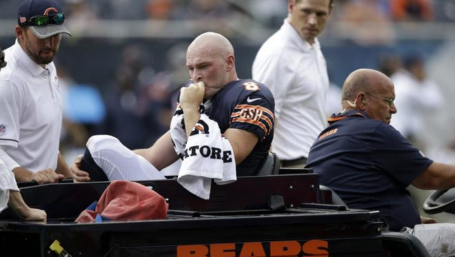 Chicago Bears quarterback Connor Shaw (8) is escorted off the field after getting hurt on a play during the second half of an NFL preseason football game against the Kansas City Chiefs, Saturday, Aug. 27, 2016, in Chicago. The Chiefs won 23-7. (AP Photo/Tom Lynn)