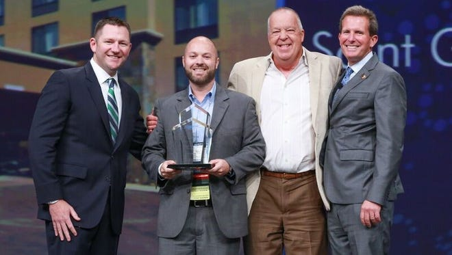 From left, Brian Krause Vice President of the Brand Operations of Wingate by Wyndham, Tim James General Manager at Wingate, Steve Sparks Wingate managing partner and Goeff Ballotti President and CEO of the Wyndham Hotels pose for a photo after James receives the award for Wyndham Hotel group Hotel of the Year midscale tier North America at the 2016 Wyndham Hotel Group Global Conference in Las Vegas.