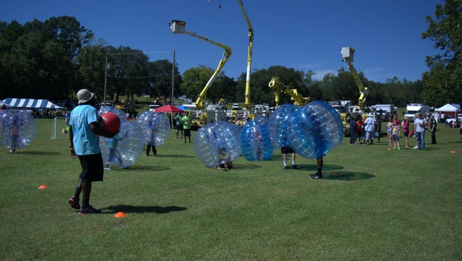 Community members play bubble soccer at the community picnic to honor Hermine relief workers.