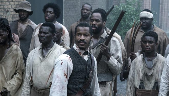 "Nate Parker as Nat Turner (center) stars in ""The Birth of a Nation,"" which opened with a disappointing $7.1 million, according to studio estimates Sunday, Oct. 9, 2016."