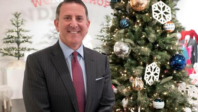 Target Chairman and CEO Brian Cornell poses with a Christmas tree during a media presentation, Tuesday, Oct. 25, 2016, in New York. Since assuming the CEO post in August 2014, Cornell has been trying to reinvigorate Target's cheap-chic status and focus on categories like fashion, home furnishings and wellness items.