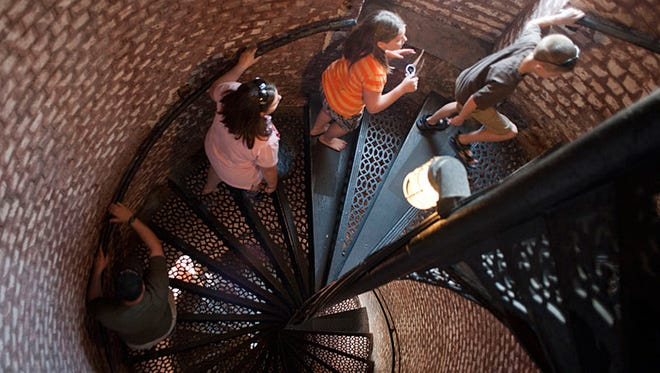 A group of local students climb the Pensacola Lighthouse on a recent visit.