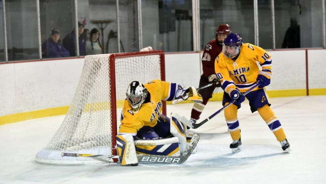 Elmira's Rachel Grampp (10) and goalie Kyle Nelson watch the puck during Saturday's tie against Norwich.