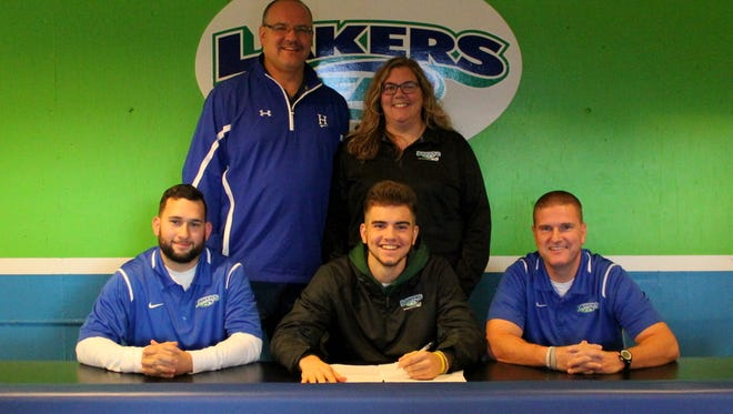 Austin Andryshak, front center, signs a Letter of Intent to play men's lacrosse at Ohio Valley University during a Nov. 11 ceremony at Finger Lakes Community College.