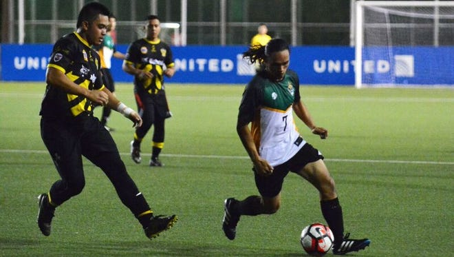 The UOG Tritons' Jose Babauta with the ball in match with the Bobcat Rovers. The Rover won 3-1.